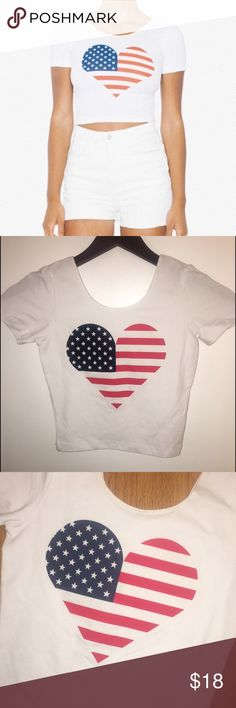 American Flag Heart Crop Top The perfect summer crop top with Memorial Day and the 4th of July around the corner! 95% cotton, 5% elastane. Heart American flag print on front, solid white on back. Multiple sizes available. BRAND NEW with tags. No longer sold in stores or online. MADE IN AMERICA ❤️🇺🇸 American Apparel Tops Crop Tops