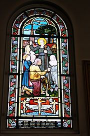 Stained glass depicting St. Louis de Montfort who explained how an initially Christocentric view of salvation leads to total consecration to the Blessed Virgin.[28]