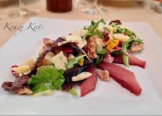 """One of the new salads """" Autumn Harvest Salad """" radicchio, root vegetables, smoked bleu cheese, shaved fennel, poached pears, candied walnuts and cider vinaigrette."""