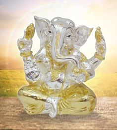 Gold and Silver Ganesha 4-Arms - An elegant piece of art that adds to the elegance of the idol with its two-tone color combination.