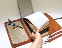 Leather sketchbook case with pen holder and cross door erikasleather