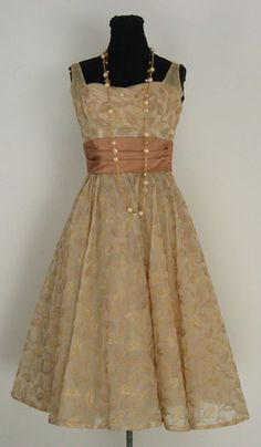Vintage dress...  I like the color of the dress, but not the waist band.