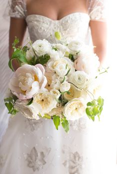 Bouquet of blush peonies, Juliet garden roses, vibrant greenery, and other ivory blooms