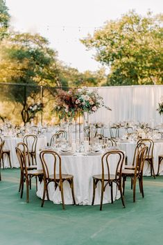 This incredible backyard wedding in California is the stuff dreams are made of! With a double sided floral arbor in blush and sage hues, pops of black in the wedding stationery flatware, we are in LOVE with every chic detail.