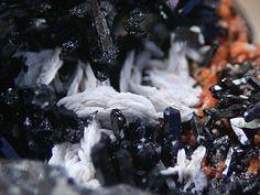Gaudefroyite, Ca4Mn+++3-x(BO3)3(CO3)(O,OH)3, and Baryte, N'Chwaning II, Hotazel, South Africa. Copyright geni