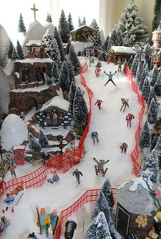 A Guide to Christmas Party Games Christmas Tree Village, Department 56 Christmas Village, Christmas Town, Christmas Villages, Christmas Holidays, Christmas Ornaments, Halloween Village Display, Christmas Wreaths, Outdoor Christmas Decorations