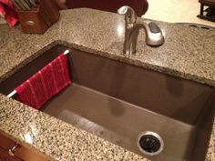 I am not a fan of hanging my dishcloth or dish towels on the inside of my cabinet door. So, I put a curtain tension rod in my single bowl sink for my dishcloth to conveniently hang and dry on. by lenore