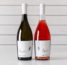Una coppia di etichette per una coppia di vini, un bianco e un rosato, della cantina salentina Schola Sarmenti