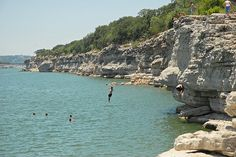 Cliff diving at Pace Bend Park Approximately 30 miles west of Austin on Lake Travis, the north and east side of the park have shallow beaches perfect for children and dogs. Admission is $10 per car. (2011 Pace Bend Rd N)