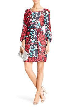 Eribec printed chiffon belted dress. The flirty Eribec dress is a playful silhouette for all seasons. With a wide self-tie obi belt and subtle bell sleeve. Lined through the bodice. With side pockets. Pull on style. Fit is true to size. Falls to above knee when belted.