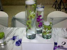 Decoracion en cilindros y orquideas