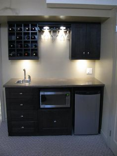 It has wine storage, fingertip sink, microwave (popcorn for movies), and a small refrigerator).