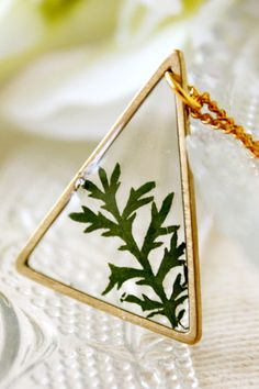 A pressed leaf, transformed into a necklace
