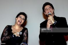 Indian Bollywood film actors Shah Rukh Khan (R) and Kajol Devgan pose during the celebration of the successful completion of 1000 weeks of screenings, since its release in 1995, of their romantic Hindi film 'Dilwale Dulhania Le Jayenge' (DDLJ) written and directed by then-debutante director Aditya Chopra and produced by his father, the late Yash Chopra during a special screening at the Maratha Mandir theatre in Mumbai on December 12, 2014. DDLJ is the longest running Bollywood film ever…