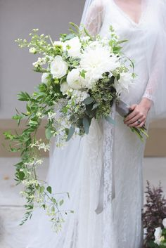 White bridal bouquet with cascading greenery | White Linen Photographers | see more on: http://burnettsboards.com/2016/01/downton-abbey-wedding/