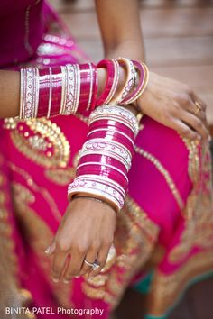 Love this ethereally bridal image - traditional hot pink chuda / choora with the stunning simplicity of a solitaire diamond engagement ring - Indian wedding - Indian bride - Punjabi bride - Hindu bride - Sikh bride - wedding bangles #thecrimsonbride