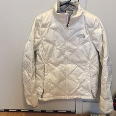 """The North Face White Down Jacket Size medium, fits small or medium great. White down coat with grey lining 550-fill down insulated. Most similar to the current The North Face """"Aconcagua"""" coat. This coat is amazing. Just cleaned, excellent condition. There is a slight discoloring by the right pocket, but it's very difficult to see unless you look very closely. Pockets zip close. No trades. The North Face Jackets & Coats Puffers"""