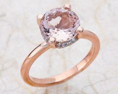 Ladies 14kt rose gold diamond engagement ring. The center is a 8X6 natural PEACH morganite Total diamond weight on the ring is 0.40carats of F/G