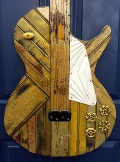 "Les Paul ""Goldtop"" Guitar made from Reclaimed Wood and Found Objects by RidleyStallingsArt on Etsy Reclaimed Wood Art, Rustic Wood Walls, Recycled Wood, Woodworking Guide, Custom Woodworking, Woodworking Projects Plans, Router Projects, Guitar Wall Art, Barn Wood Crafts"