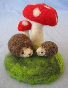 needle felted hedgehogs and toadstools. Love the toadstools. Go with gnome?