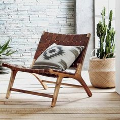 Available for Pre-Order   Ships out March 1. Place your order now to reserve your Chair! Our low, woven leather chair makes lounging an inescapable temptation. Leather straps in a rich caramel color a