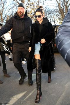 Protected: Kendall Jenner, pictured in Paris, had a special handler and additional security for the VS Fashion Show following Kim Kardashian's robbery at gunpoint in the French capital
