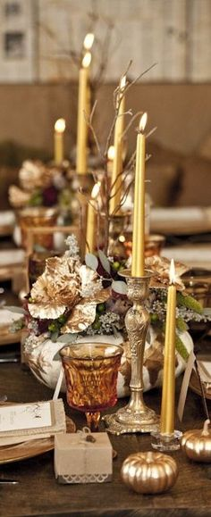 Gold and rose gold table inspiration with taper candles, painted pumpkins, and much more at a fall wedding!