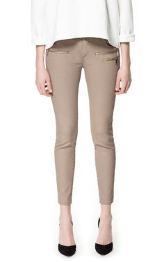 COATED TROUSERS WITH ZIPS from Zara    You ladies that don't have hips can so get away with this pant and work it well! This would look super earthy, if paired with olive or clay colors. Add some rose pinks for a little more color!