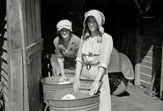 "Washboard Abs: March 1936. ""Women washing clothes. Crabtree Recreational Project near Raleigh, North Carolina."" 35mm nitrate negative by Carl Mydans for the Farm Security Administration."