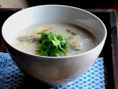 Rice Soup for breakfast My grandmother loved rice soup for breakfast. And I can recall a memory– I often joined her savoring this soul food before our day began. To this day when I visit Thai… Rice Porridge, Porridge Recipes, Soup Recipes, Free Recipes, Breakfast Soup, Best Breakfast Recipes, Chicken Rice Soup, Thai Chicken, Thai Cooking