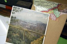 beautiful wedding invitation with travel photo and map-lined envelopes / mama's sauce
