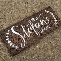 Made to order family name sign.   DETAILS: 7.5 x 18 long x 3/4 thick Oak wood with a dark stain applied. Painted with: Family name, date and