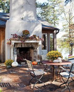 Reminiscent of a French country cottage, this house brims with rustic touches, such as rough-hewn ceiling beams and a France-imported fireplace. Outdoor Dining, Outdoor Spaces, Outdoor Decor, Pavillion, Victoria Magazine, Outside Living, French Country Cottage, Back Patio, Autumn Garden