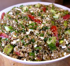 Greek Spinach Tabbouleh: spinach, bulgar wheat, scallions, cucumber, cherry tomatoes, feta and a lemon vinaigrette.
