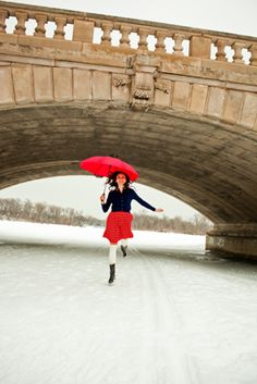 Young woman with red umbrella, Minnesota winter