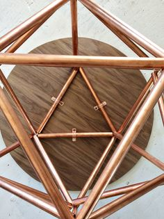 Brittany Cramer of brittanyMakes created a copper pipe himmeli base for a DIY side table. It looks amazing. She explains how she made it on The Home Depot Blog. || @brittanymakes