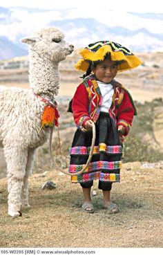 Quecha Indian child with her llama
