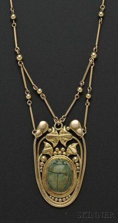 Arts Crafts Egyptian Revival necklace with scarab pendant set in an Egyptian motif frame, faience and gold.
