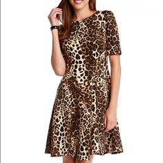 "Karen Kane Leopard Print Scuba Dress Step out in style in this leopard print fit-and-flare dress. Pair this piece with your favorite black heels or flats for a modern look.                            Product details: Polyester/spandex. Crew neckline. Back zipper neckline. Short sleeves. Hits above knee. Approximately 35.5"" L. Dry clean only. Made in USA. Karen Kane Dresses"
