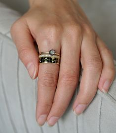 This chic ensemble is giving us serious vintage vibes! The Delphine Stack is a mix of three 14K and 18K yellow gold rings stacked to moody, antiqued perfection.