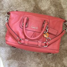 Coach Ashley Bag Coral doctor bag style used a few times excellent condition. Coach orange charm is not included--lock style. Coach Bags