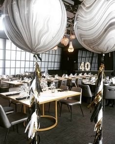 Our giant marble balloons with black, white and gold tassles
