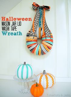 DIY Halloween mason jar lid wreath- this is a fun and unexpected color scheme for fall/ Halloween. I especially like the bright washi tape pumpkins. Pot Mason, Mason Jar Lids, Mason Jar Crafts, Wreath Crafts, Diy Wreath, Decor Crafts, Diy Crafts, Wreath Ideas, Halloween Mason Jars
