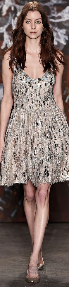 Jenny Packham.Fall 2015. I am really liking this fun, sexy number. Super cute and the embellishments running throughout the whole garment makes it top notch. Definitely a girls night out kind of dress. Kristen Stewart would look fab in this.