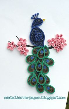My second try quilling a peacock.  This time it has more green/blue.  It is resting on a branch of cherry blossom tree.  I like this one be...