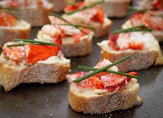 Top bread with lobster, aioli and chives to make this appetizer.