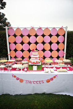 backdrop and wheat grass and fresh tulip display for cake stand to sit on