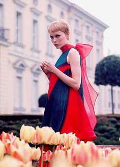 Designer Pierre Cardin made this stunning piece exclusively for Mia Farrow in A Dandy in Aspic.  Accordian pleated shift dress, accessorized with a beautiful red scarf.