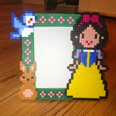 My First picture frame. #frame #pictureframe #disney #snowwhite #disney #disneyprincess #pixelart #beadsprites #beads #8bit #hama