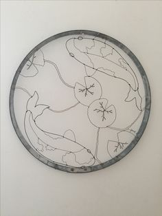 """""""Koi Pond""""  Wire drawing by Janet McBeen framed in a wine barrel hoop"""